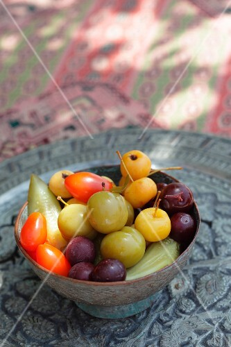 A bowl of colourful, exotic fruits