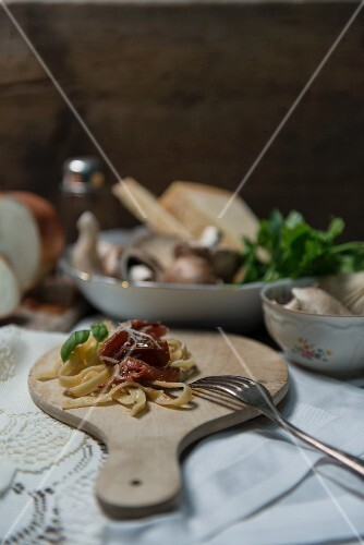 Tagliatelle with tomato ragout, basil and Parmesan cheese