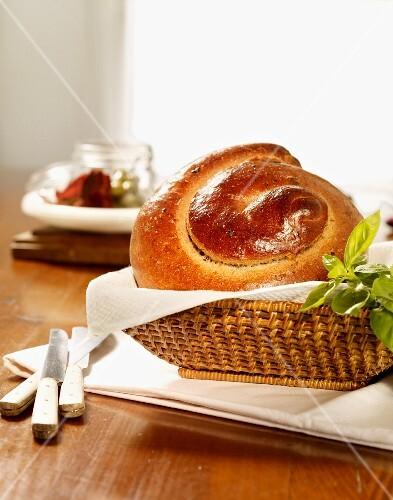 Olive bread spiral in a bread basket
