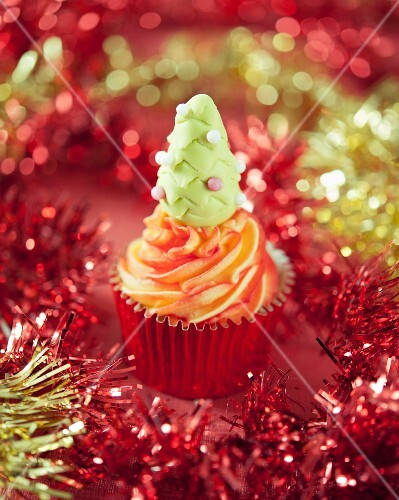 A Christmas cupcake decorated with a fondant tree