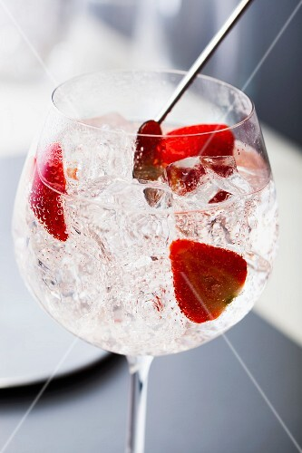 A gin and tonic with strawberries