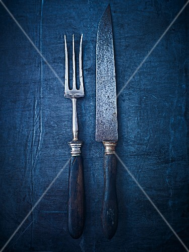 An antique meat fork and knife (seen from above)