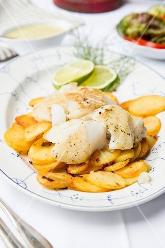Fried fish with fried potatoes and mushroom sauce