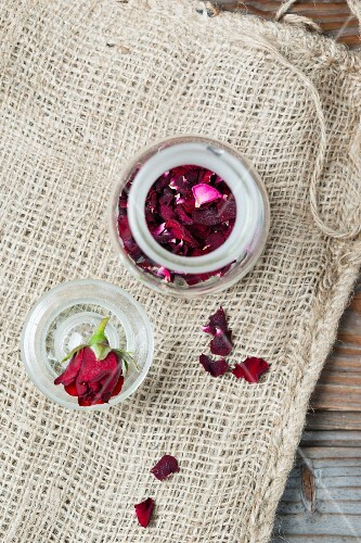 Dried rose petals in a glass jar (seen from above)