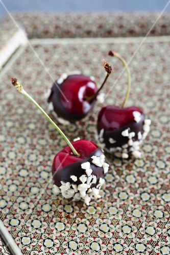 Chocolate-coated cherries with chopped almonds