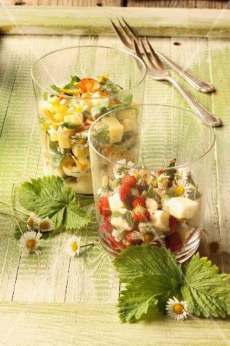 Cheese salad with edible flowers and wild herbs