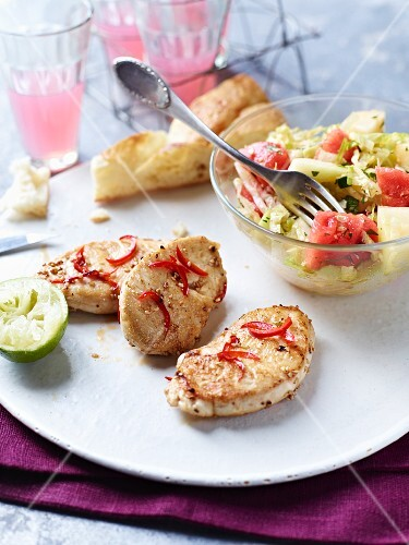 Mini turkey steaks with chilli and lettuce with melon