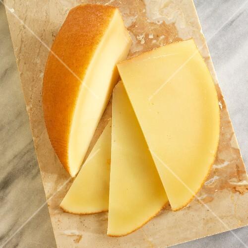 San Simon cheese (smoked Spanish cheese) on a marble chopping board