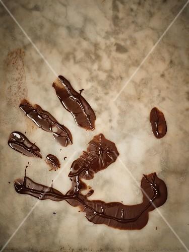 A chocolate handprint