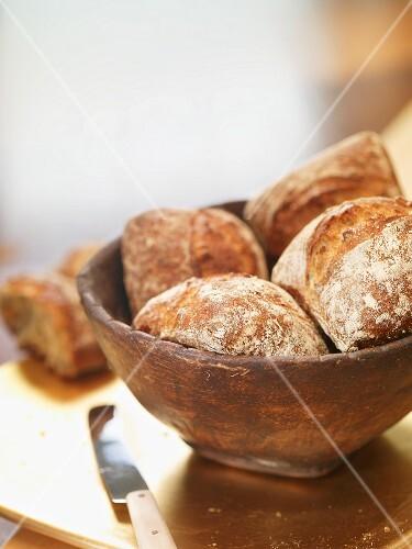 Bread rolls in a wooden bowl