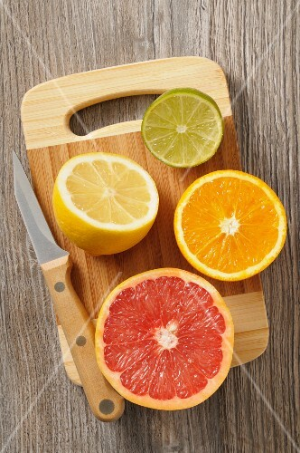 Juicy citrus fruits on a wooden chopping board
