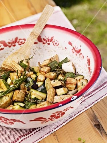 Mediterranean vegetable salad in a colourful enamel bowl