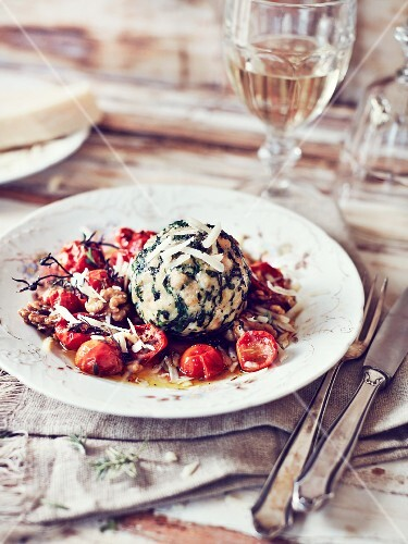 A spinach dumpling with caramelised tomatoes