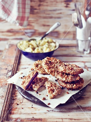 Vegetable escalopes with a walnut crust served with potato salad