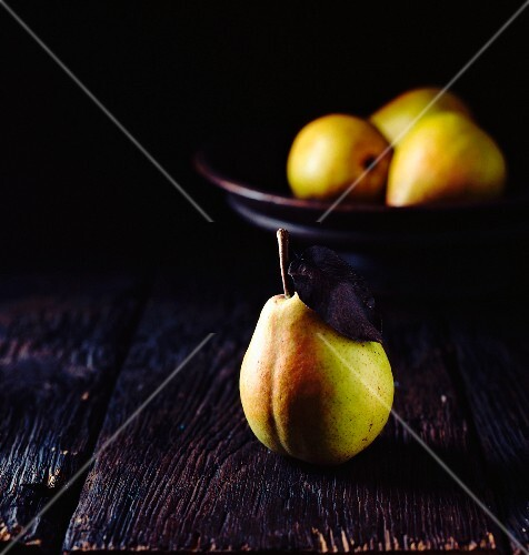 Fresh pears on a black surface