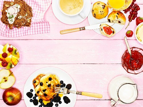 Breakfast with scones, pancakes, bread and fruit salad (seen from above)