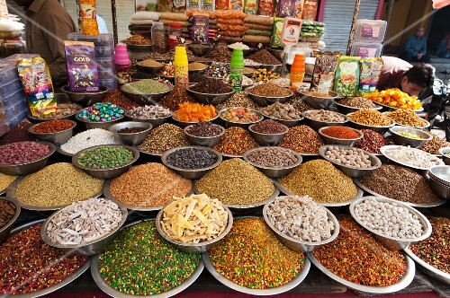 Spices and suites at a market stand (Ahmedabad, Gujart, India)