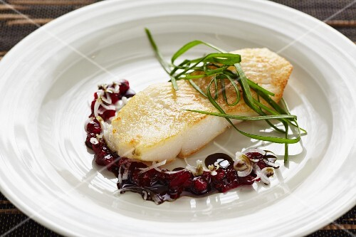 Halibut with a seed oil and lingonberry sauce