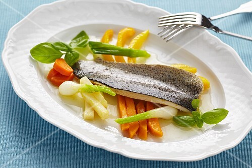 Poached trout with glazed vegetables