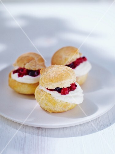Profiteroles filled with cream cheese and berries
