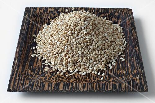 Sesame seeds on a coconut wood dish