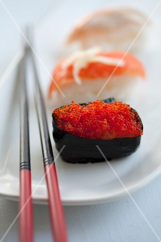 Sushi with salmon caviar and salmon