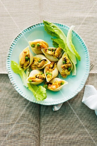 Shell pasta filled with paella served with cos lettuce