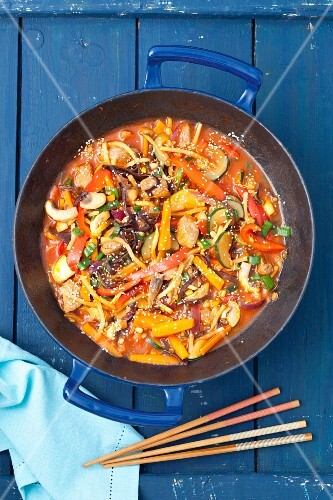 Sweet and sour pork with vegetables and mushrooms