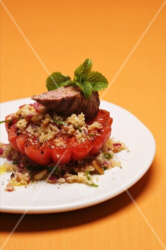 Tomato stuffed with couscous and lamb fillet