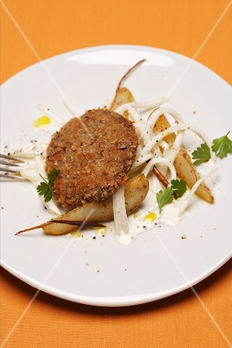 Venison escalope with cinnamon pears