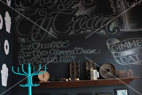 A decorative black wall in a vegan bakery