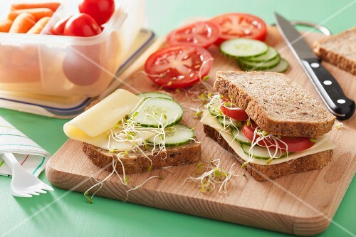 A cheese, cucumber, tomato and bean sprout sandwich for lunch box