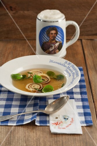 Flädlesuppe (Swabian soup made with pancake strips) with Brussels sprouts leaves