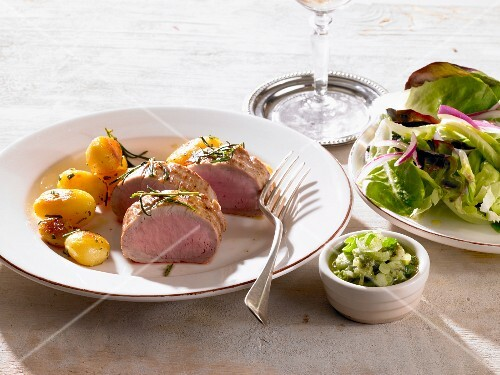 Pork fillet with rosemary potatoes and a side salad