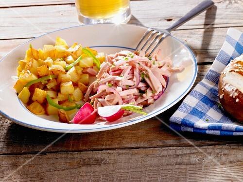 Fried potatoes with a sausage salad (Bavaria, Germany)
