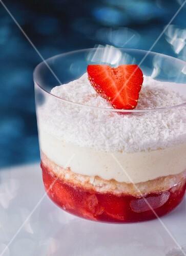 A strawberry desert with coconut and vanilla cream