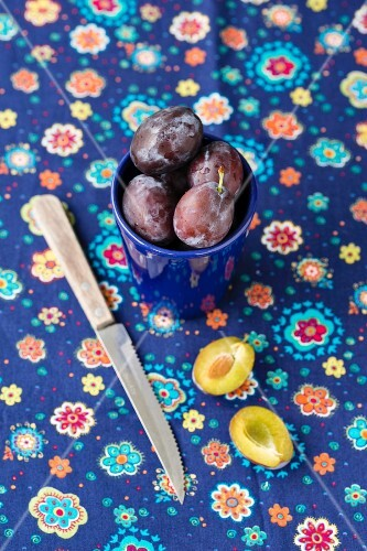 Damsons in a blue cup
