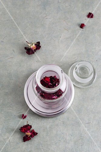 Dried rose petals in a medicine jar