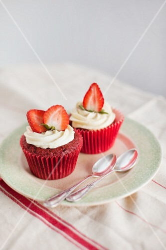 Strawberry muffins decorated with cream