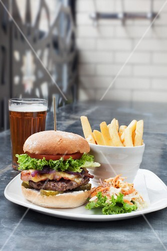 A burger with chips and beer