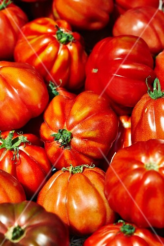 Beefsteak tomatoes on a market stand