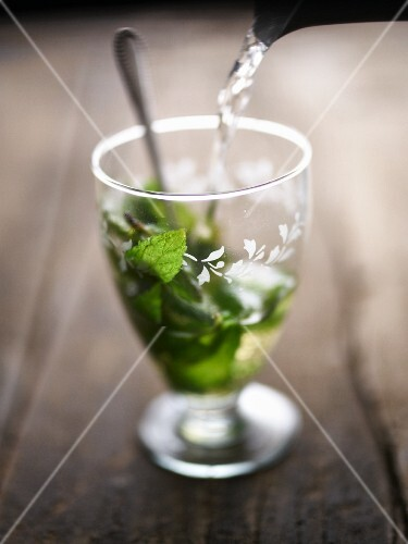 Peppermint tea being poured