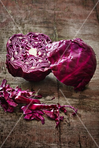A halved red cabbage on a wooden board