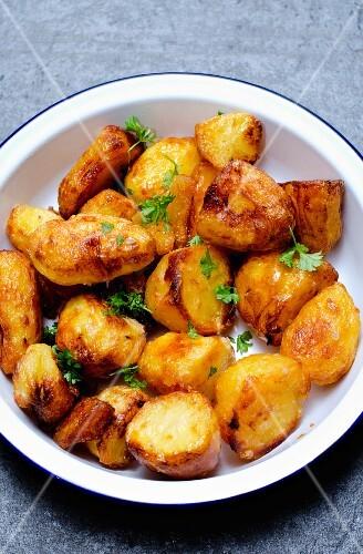 Roast potatoes in an enamel bowl