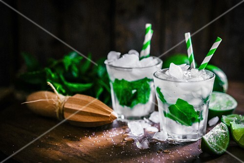 Mojitos with ice cubes, mint and limes