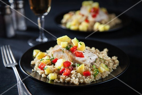 Fried mahi with pineapple and pepper salsa served on quinoa