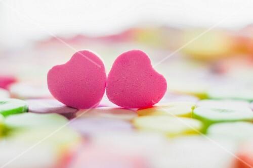 Two pink sugar hearts