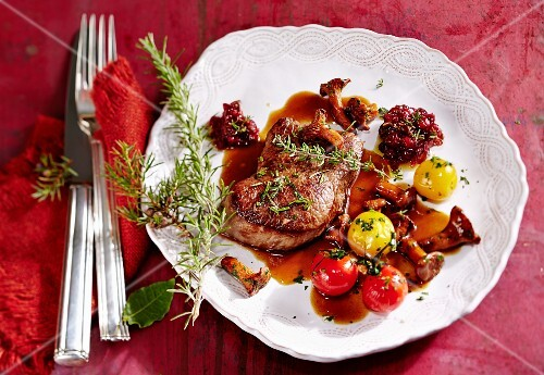 Chilli lingonberries with venison steaks
