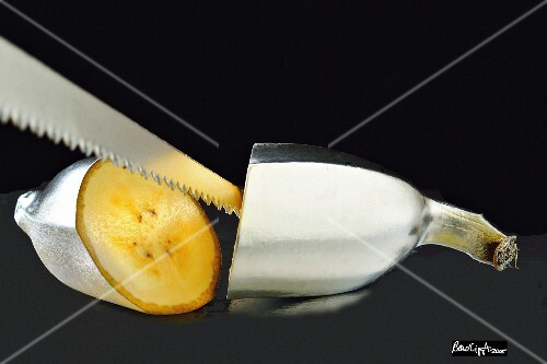A silver banana with a saw