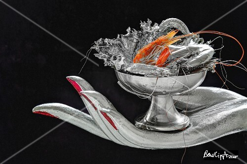 A silver hand holding a a dish of silver-coated prawns